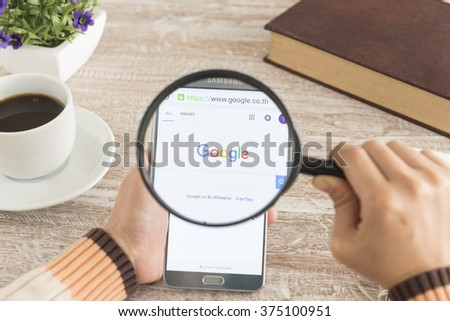 BANKKOK, THAILAND - FEBRUARY 11,2016: Human hands using a smartphone notes 5 show Google search. - stock photo