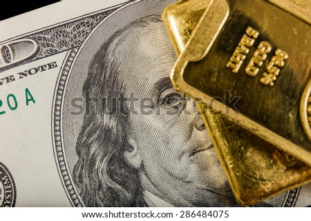 banknote and gold bullions - stock photo