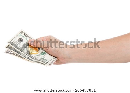 banknote and gold bullions in hand isolated on white - stock photo