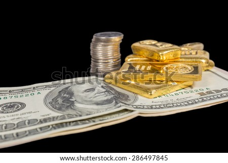 banknote and gold bullions isolated on black - stock photo
