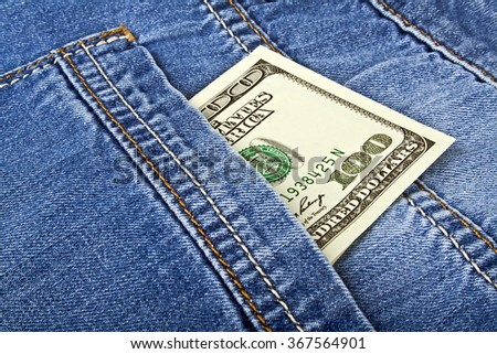 Banknote of one hundred american dollars in jeans pocket