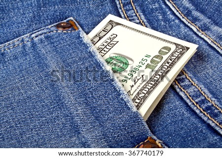 Banknote of one hundred american dollars in jeans pocket - stock photo