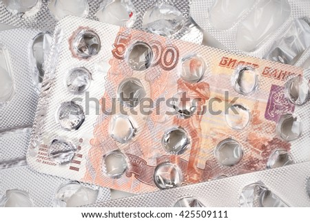 Banknote 5000 russian rubles on an empty blister pack of tablets - stock photo