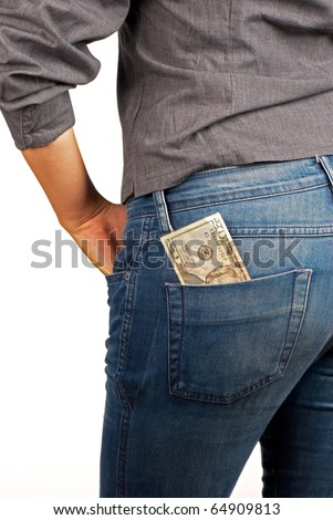 Banknote tucked in jeans backpocket, pocket money concept - stock photo