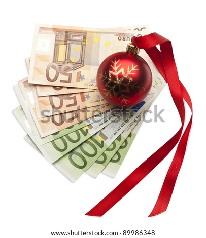 banknote with Christmas ball - stock photo