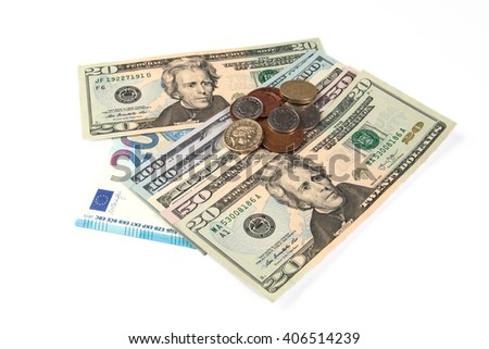 Banknotes and coins on a white background. - stock photo