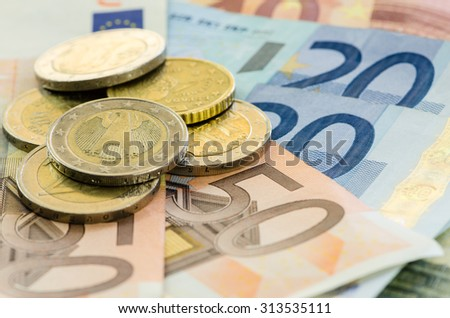 banknotes and detail of coins image