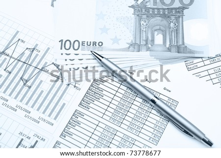 Banknotes and pen on financial papers - stock photo