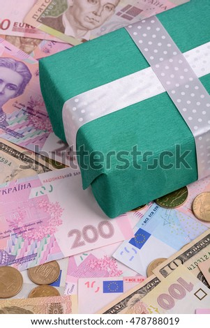 banknotes, clear image of dollars and new bills Ukrainian national currency hryvnia with gift box