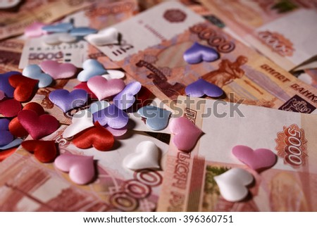 banknotes five thousand rubles and one hundred dollars and small  hearts - stock photo