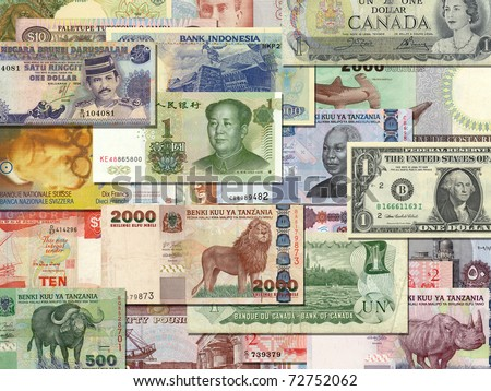 banknotes from different countries overlapping each other - stock photo