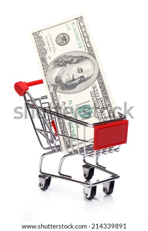 Banknotes in small shopping trolley over white background