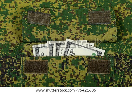 Banknotes in the military uniform pocket - stock photo