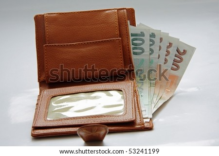 Banknotes in wallet on white background - stock photo