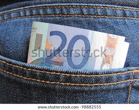 Banknotes in your pocket, euros in jeans. - stock photo