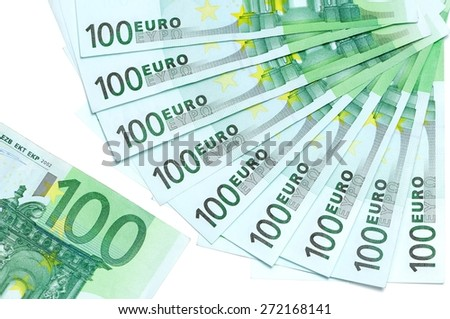 Banknotes of 100 euro are located around as fan and part of 100 euro banknote on a white background - stock photo