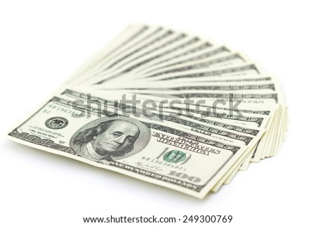 Banknotes of one hundred dollars folded fan isolated on white background - stock photo