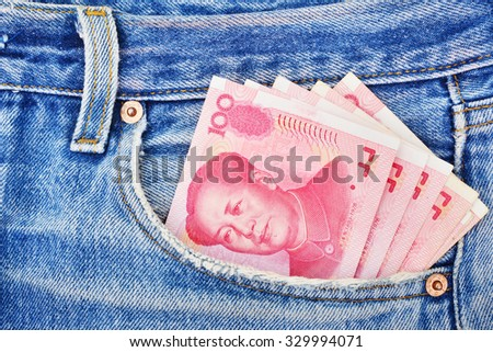 Banknotes of one hundred yuan in the jeans pocket - stock photo