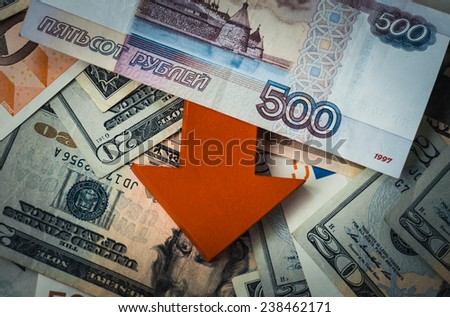 Banknotes of russian roubles on us dollars and european euros. - stock photo