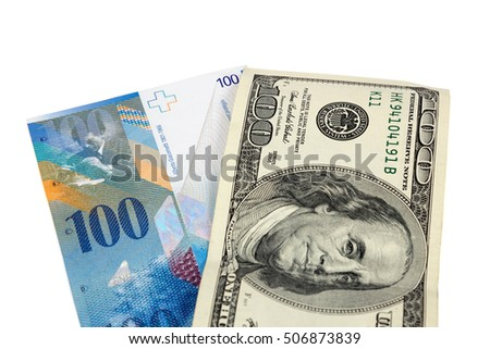Banknotes of 100 US dollars and swiss franc isolated on white background with clipping path