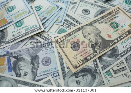 banknotes to ten and one hundred USD