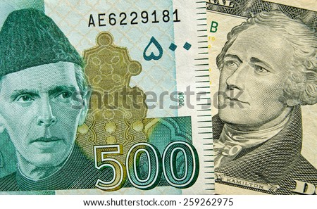 Banknotes with founding fathers.  The Pakistan 500 rupee with Jinnah and 10 dollar bill with Hamilton, one of the US founding fathers.   Used banknotes, shown at an angle with less than 80% displayed. - stock photo