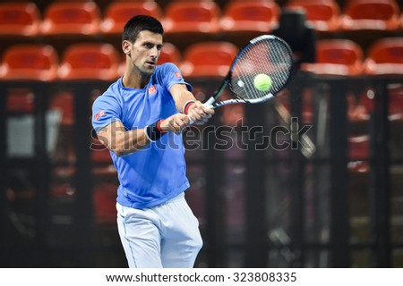 BANKOK THAILAND OCTOBER 01:Serbia's Novak Djokovic  returns a backhand  during a training session ahead of their exhibition tennis match at the Hua Mark indoor stadium  on Oct 1, 2015 in Thailand.  - stock photo