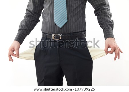 Bankrupt business person with empty pockets - stock photo