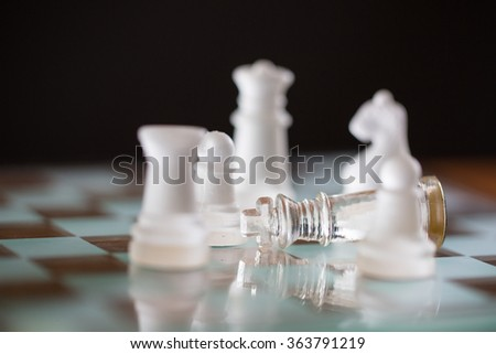 bankrupt concept with King Chess falling after finish game chess. - stock photo