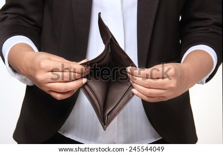Bankrupt person showing empty wallet - stock photo