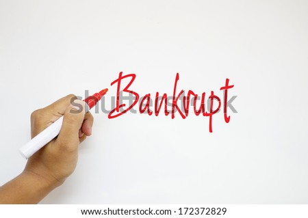 Bankrupt sign on whiteboard - stock photo
