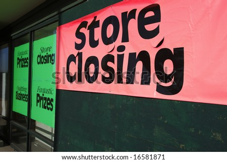 Bankrupt store with closeout signs. - stock photo