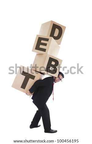 Bankruptcy concept: businessman out of business carrying heavy boxes representing company debt - stock photo