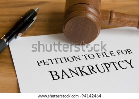 Bankruptcy concept with judge's wooden gavel and petition notice - stock photo