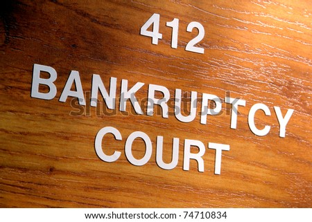 Bankruptcy court sign outside an insolvency case resolution and judgment chamber in a courthouse - stock photo