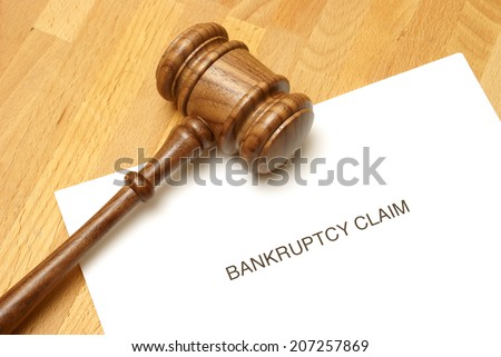 Bankruptcy forms and a gavel to represent this monetary concept. - stock photo