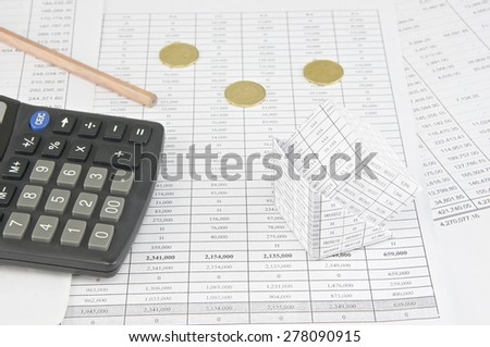 Bankruptcy of house near  gold coins and calculator with pencil place on finance account. - stock photo