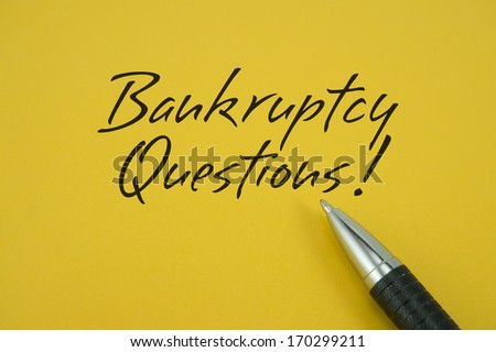 Bankruptcy Questions note with pen on yellow background - stock photo