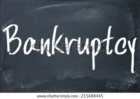 bankruptcy word write on blackboard - stock photo
