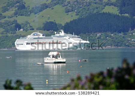 BANKS PENINSULA, NEW ZEALAND, DECEMBER 22, 2011 - Akaroa remains first choice for cruise ships since Christchurch port facilities were damaged by earthquake; Banks Peninsula, New Zealand, 22-12-2011 - stock photo