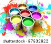 Banks with a paint of different colours are collected together - stock vector