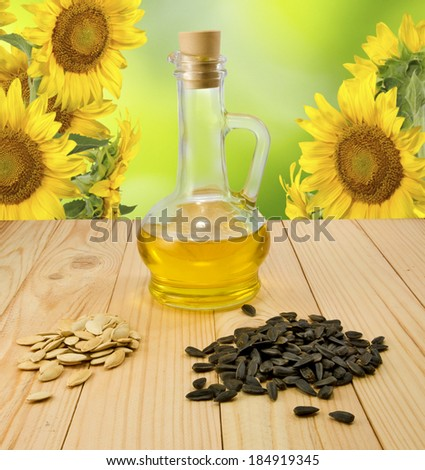 banks with sunflower oil and  seeds on a sunflower background - stock photo