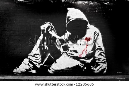 Banksy Hoodie with Knife Graffiti - stock photo