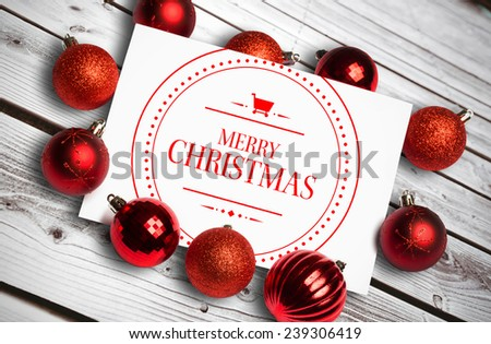 Banner and logo saying merry christmas against digitally generated grey wooden planks - stock photo