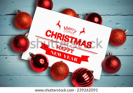 Banner and logo saying merry christmas against painted blue wooden planks - stock photo
