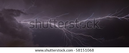 Banner image of a Massive cloud to cloud lightning strike - stock photo