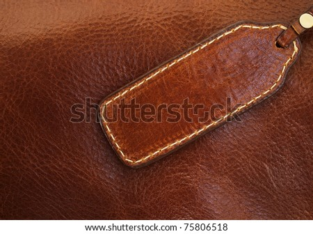Banner made ??of brown leather stitching gold thread - stock photo