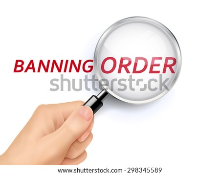 banning order showing through magnifying glass held by hand