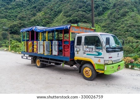 BANOS, ECUADOR - JUNE 22, 2015: Open-sidd truck called Chiva is being used for passenger transportation in Ecuador - stock photo
