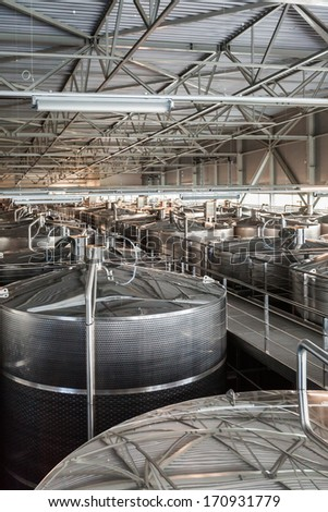 "BANOVO BRDO, CROATIA - MAY 5, 2012: Interior of winery ""Belje"", a modern winery worth 20 million Euros, with more than 200 chrome tanks for holding wine and capacity of 8 million liters."